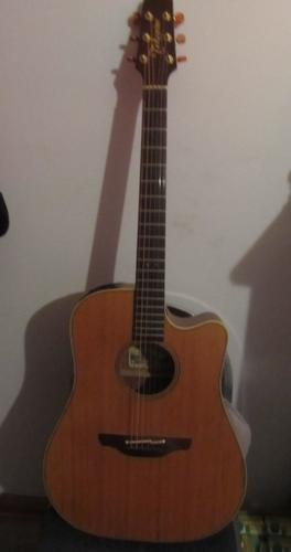 Takamini Guitar $950, built in tuner, hard case, good condition