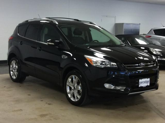Ford Escape TITANIUM PKG WITH NAVIGATION•CHARCOAL BLACK, HEATED LEATHER-TRIMMED BUCKETS.•TRANSMISSIO