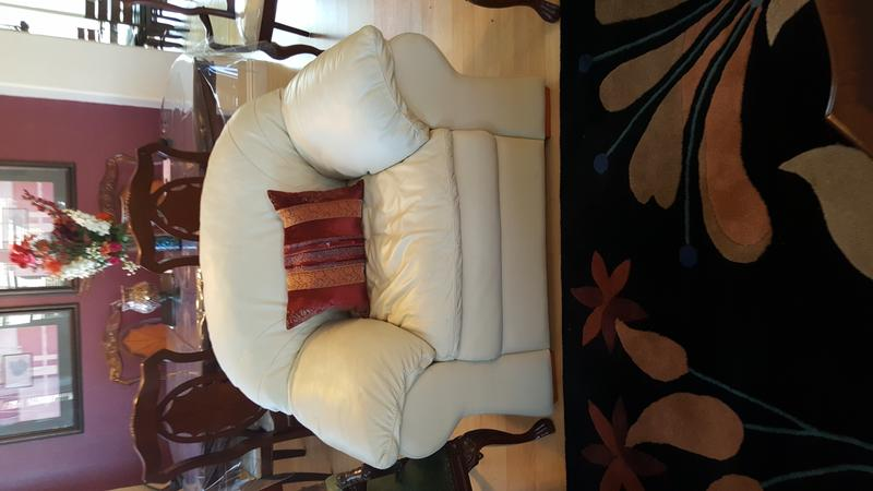 leather couch with matching ottoman$500.00 (Elk Grove)