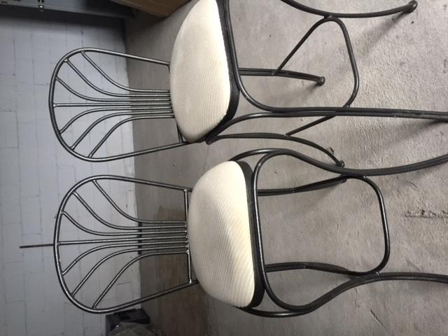 Two wrought iron bar chairs/stools