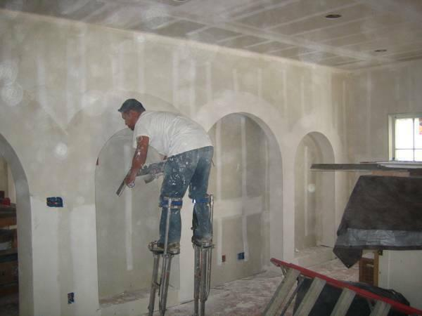Quality drywall repair specialist patches cracks water damage texture plaster