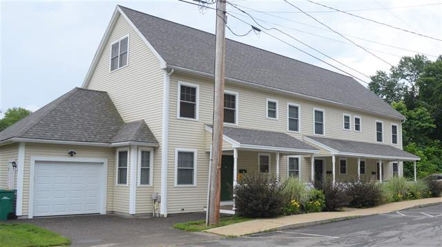NEW PRICE! Townhouse with views of the Cocheco River. Located near St Elizabeth Seton School