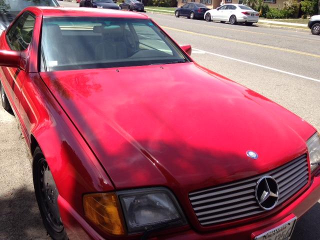 Candy red convertible 1991 Mercedes 500 SL