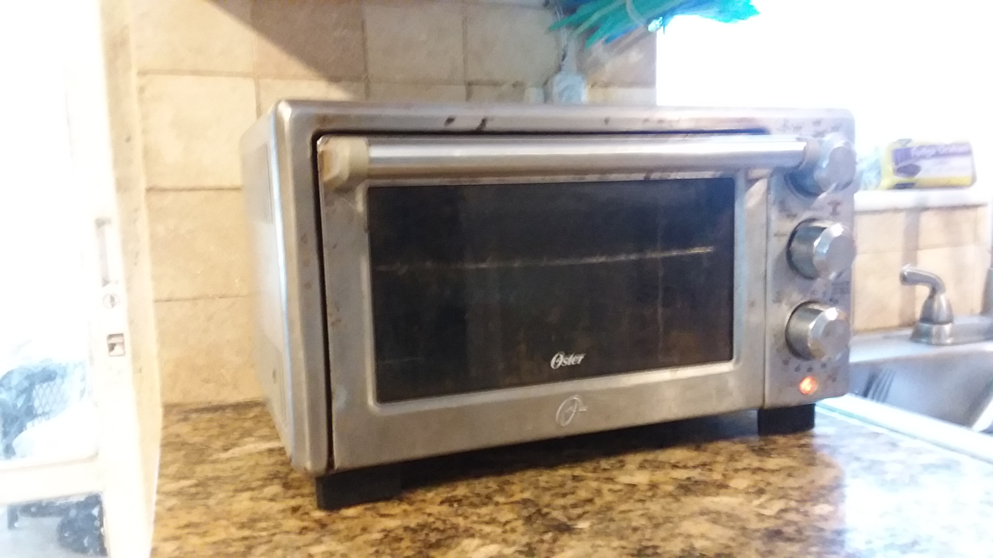 TOASTER OVEN OSTER stainless steel $25.00 WORKS GREAT