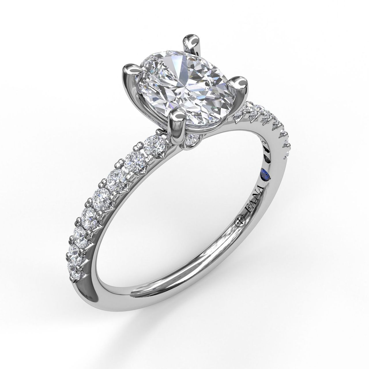 Classic Single Row Engagement ring with an Oval Center Diamond