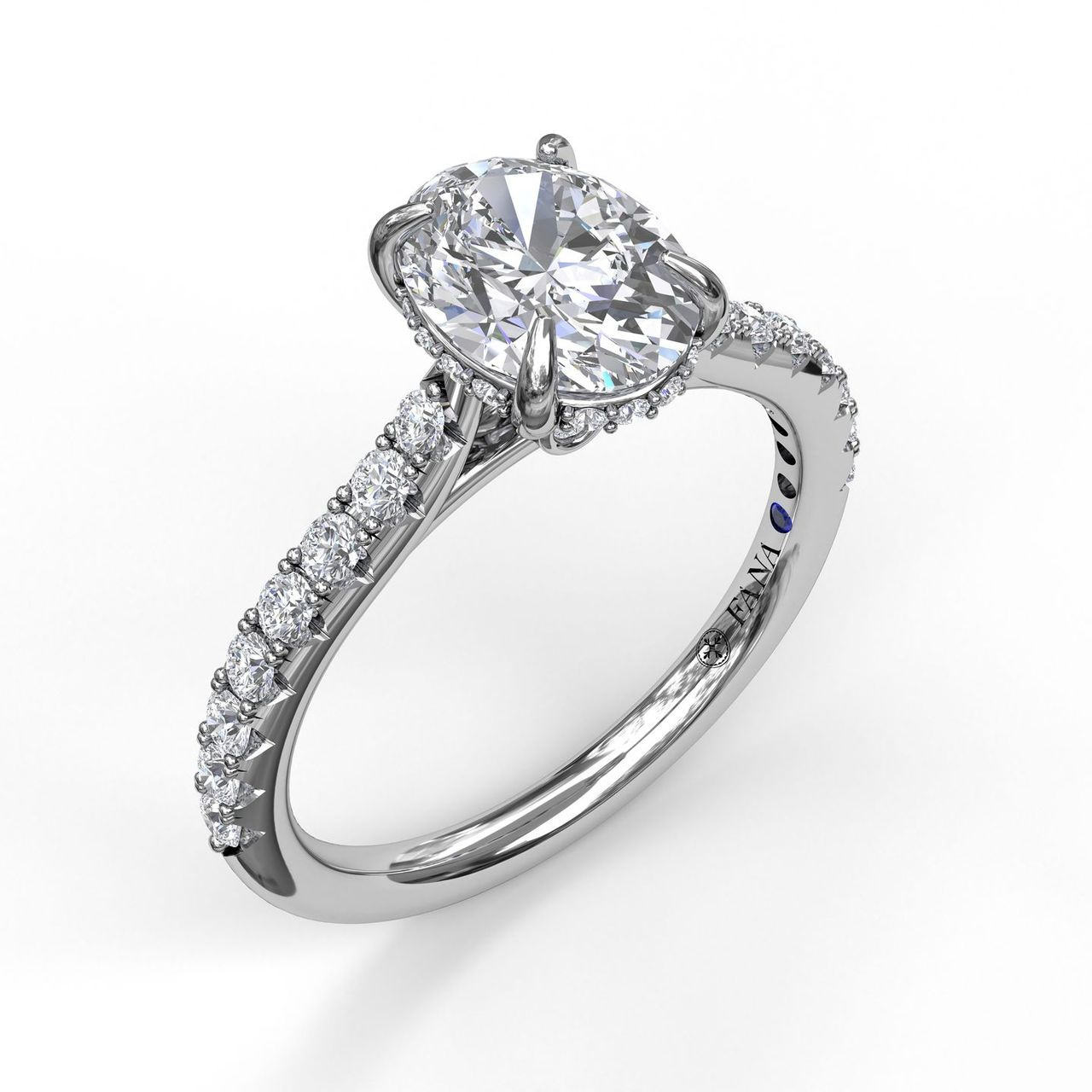 Classic Oval Cut Engagement Ring with a Subtle Diamond Splash