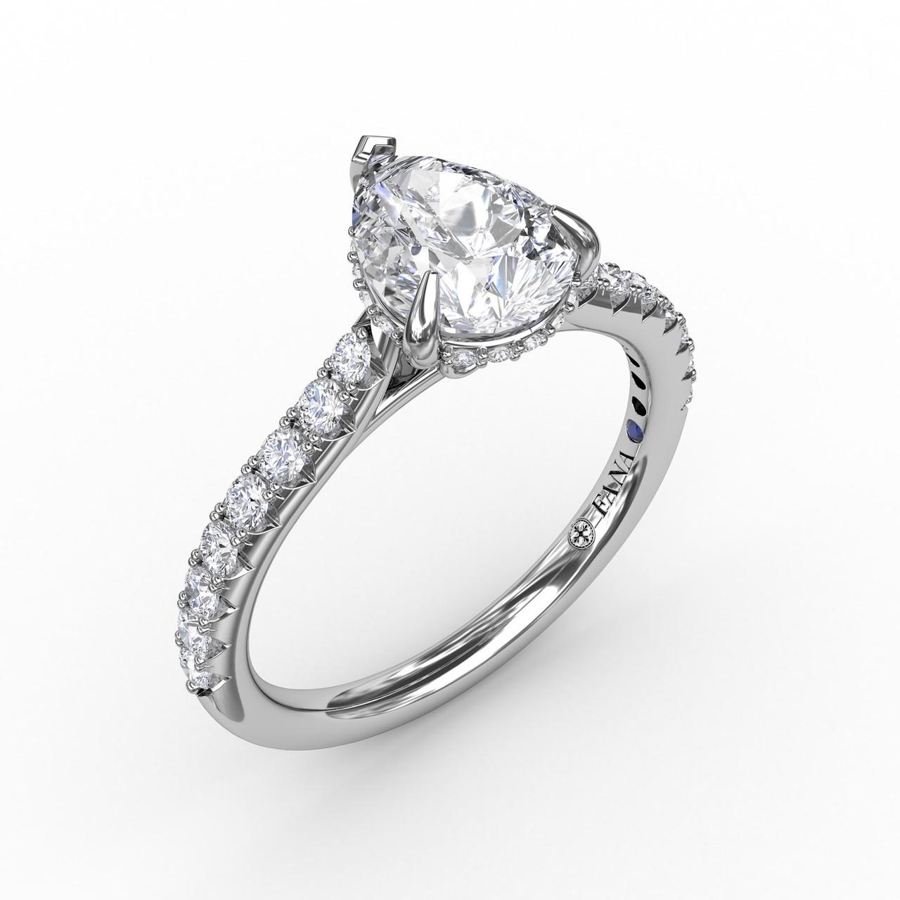 Classic Pear Shape Engagement Ring with a Subtle Diamond Splash