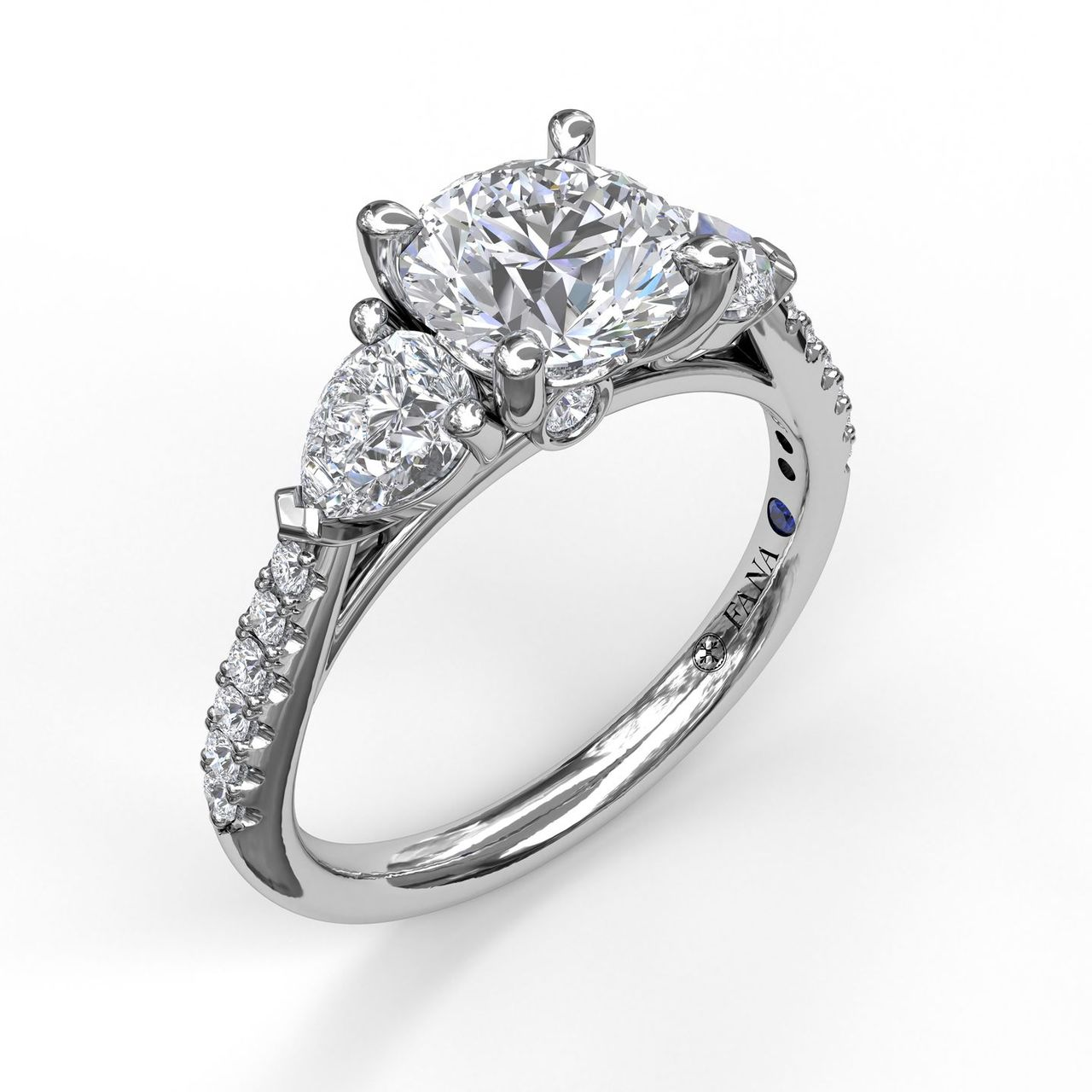 Three-Stone Engagement Ring With Pear Cut Side Stones