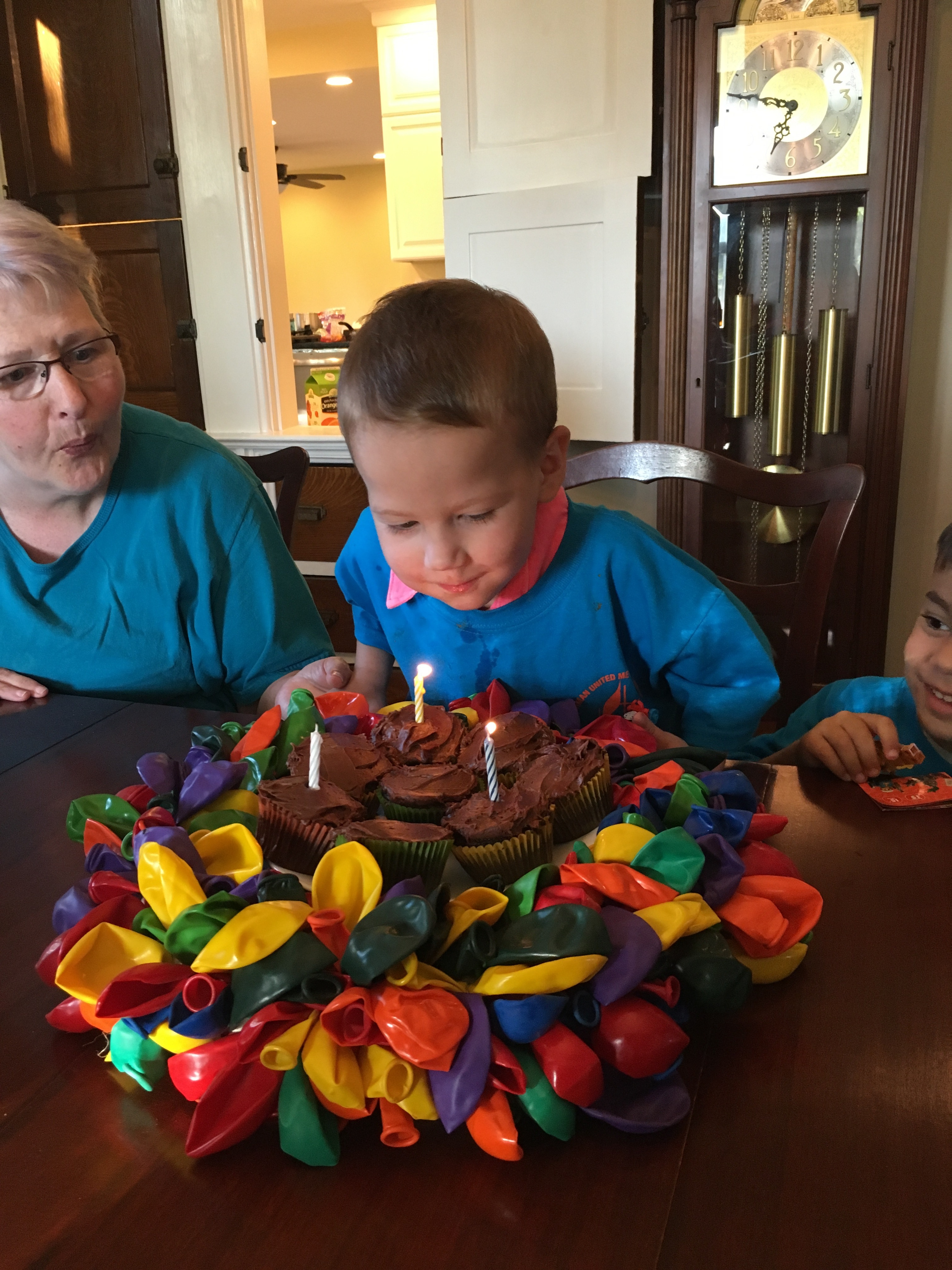 Three year old boy birthday celebration.